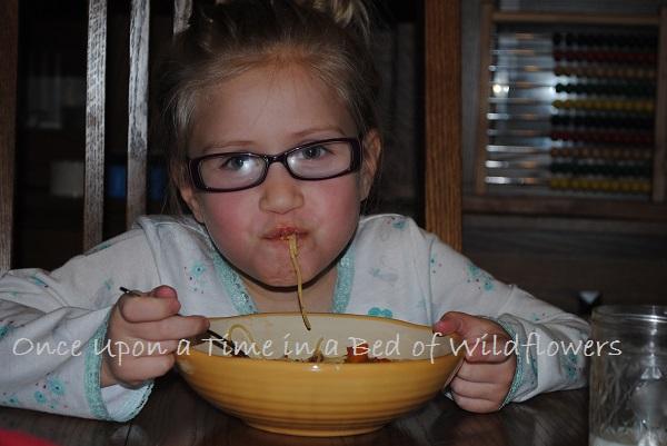 Pixie eating spaghetti